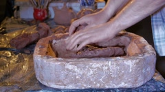 Pottery workshop, male hand mixes the clay, close up Stock Footage