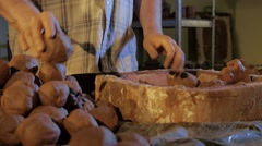 Pottery workshop, clay balls, male hands, close up Stock Footage