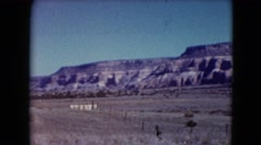 1957: dry wild mountain range with trees and man made fences  Stock Footage