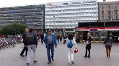 POV come across square against Helsinki Central station, pass to tram stop Stock Footage