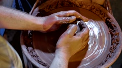 Pottery workshop, potter's wheel, close up, male hands Stock Footage