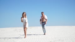 A great love story in the desert, a guy approaches a girl Stock Footage