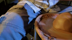 Pottery workshop, potter's wheel, male hands, close up, pan Stock Footage