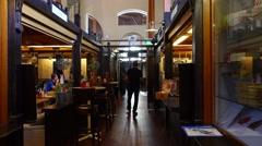 People go Inside Hietalahti Market Hall in Helsinki, POV camera Stock Footage