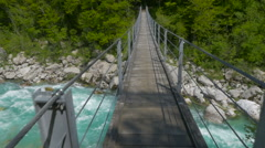 Crossing a Bridge Over White Water Stock Footage