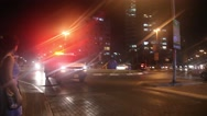 An ambulance drives down the street with the emergency lights on. With the sound Stock Footage