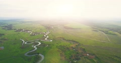 River panorama. Turn right. High up flight. 4k 30fps Stock Footage