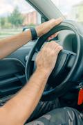 Nervous male driver pushing car horn in traffic rush hour Stock Photos