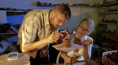Pottery workshop, working process, male, female, medium shot Stock Footage