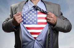 Superhero businessman revealing American flag Stock Photos