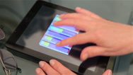 Close-up of a woman's hand on a Tablet PC. Tracking shot. Stock Footage