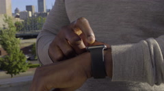 Man Uses Smart Watch, Touches Screen And Buttons On Side Of Watch Stock Footage