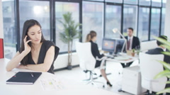 4K Businesswoman making phone call & talking to colleagues in city office Stock Footage