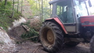 Tractor is skidding cut trees out of the forest, 4K Stock Footage