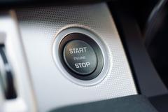 Car engine start and stop button on a hybrid car Stock Photos