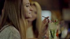 Enjoying cocktail through the straw Stock Footage