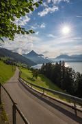 Picturesque road along an alpine lake Stock Photos