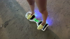 Girl feet on the hover board POV. Mini segway Stock Footage