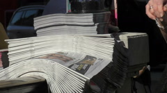 Slow Motion Evening Newspaper Pickup Hot News on the Fly Stock Footage