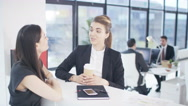 4K 2 Businesswomen in discussion in modern city office Stock Footage