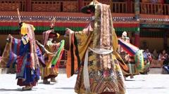 Ibetan lamas dressed in mystical mask dancing Tsam mystery dance. Ladakh, India Stock Footage