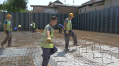 Construction workers placement armature on the floor at building site by Sheyno. Stock Footage