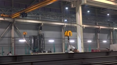 Moving of the big I-beam by electric overhead crane. Stock Footage