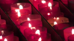 Candles with flames in church, cathedral or Basilica Stock Footage