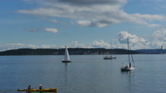 Sailboats and kayak enjoy Puget Sound at Port Townsend Stock Footage