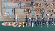 Commercial port with container ship - Aerial footage top down view Stock Footage