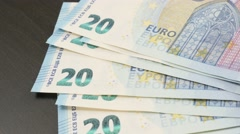 Euro money wad  drop  on table 4K 2160p 30fps UltraHD tilting footage - Falli Stock Footage