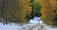 Motorcycle mountain road snow autumn colors DCI 4K Stock Footage