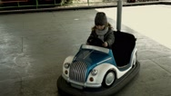 Little girl riding a toy car. Kid playing in park, children Stock Footage