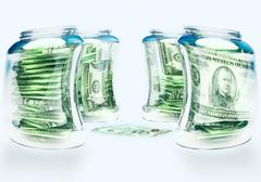 Glass flasks with money and three banknotes with coins - wealth and poverty c Stock Illustration