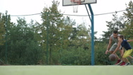 Young children, brothers and their father, playing basketball Stock Footage