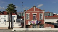 Typical portuguese house with laundry hanging from window facade for drying Stock Footage