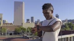 Man Uses Smart Watch On Pedestrian Bridge In City, He Swipes And Talks Stock Footage