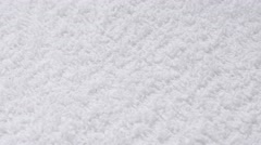 Absorbent fabric of white towel surface close-up slow tilt 4K 2160p 30fps UHD Stock Footage