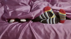 Children's feet in colorful socks. Stock Footage