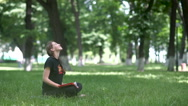 Beautiful woman relaxing and working in the park. Stock Footage