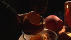 Scooping pumpkin flesh with a spoon to a plate, closeup shot, dark background Stock Footage