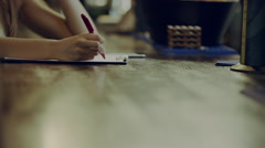 Writing on a clipboard in a bar Stock Footage
