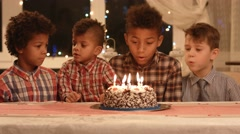 Kids blowing candles on cake. Stock Footage