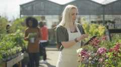 4K Portrait smiling worker in plant nursery with tablet computer Stock Footage