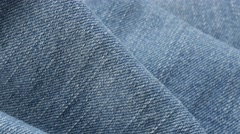 Fine light  blue denim gathers and details of texture   tilting 4K 2160p 30fp Stock Footage