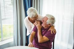 Senior couple hugging each other in a retirement home Stock Photos