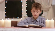 Boy is reading. Stock Footage