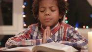 Kid is praying. Stock Footage