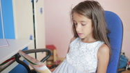 Girl schoolgirl doing homework. Girl learns lessons in the bedroom Stock Footage