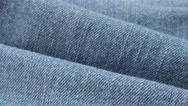 Light blue fine denim gathers and details of texture   tilting 4K 2160p 30fps Stock Footage